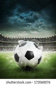 Soccer ball on the field of stadium with light - Shutterstock ID 172060076