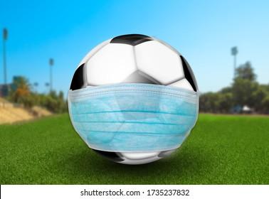 緑の草を持つサッカー場に外科用マスクを持つサッカーボール。 スポーツの試合はCovid-19で行われます。 コロナウイルスのパンデミックとサッカーの試合中止。 3Dイラスト
