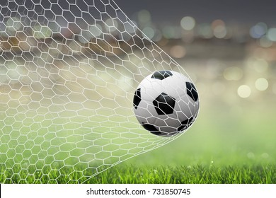 Soccer football ball in goal with white net and green football field area background. Soccer net 3D illustration.