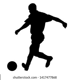 Soccer player as silhouette isolated on white while shooting a football