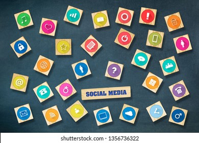 Social media concept with social icons on wooden blocks. Dark blue background.Communication tools.