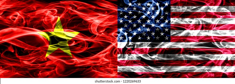 Socialist Republic of Viet Nam vs United States of America, American smoke flags placed side by side. Thick colored silky smoke flags of Vietnam and United States of America, American