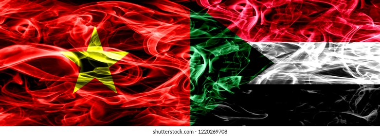 Socialist Republic of Viet Nam vs Sudan, Sudanese smoke flags placed side by side. Thick colored silky smoke flags of Vietnam and Sudan, Sudanese