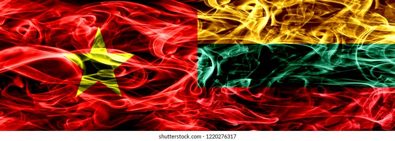 Socialist Republic of Viet Nam vs Lithuania, Lithuanian smoke flags placed side by side. Thick colored silky smoke flags of Vietnam and Lithuania, Lithuanian