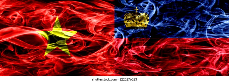 Socialist Republic of Viet Nam vs Liechtenstein, Liechtensteins smoke flags placed side by side. Thick colored silky smoke flags of Vietnam and Liechtenstein, Liechtensteins