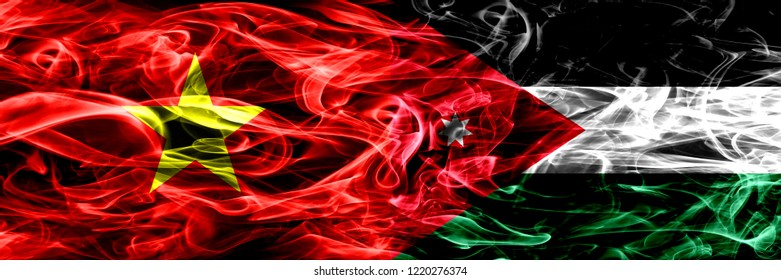 Socialist Republic of Viet Nam vs Jordan, Jordanian smoke flags placed side by side. Thick colored silky smoke flags of Vietnam and Jordan, Jordanian