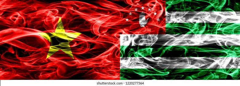 Socialist Republic of Viet Nam vs Abkhazia, Abkhazian smoke flags placed side by side. Thick colored silky smoke flags of Vietnam and Abkhazia, Abkhazian