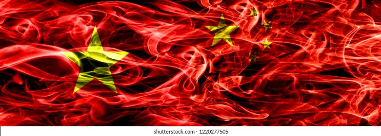 Socialist Republic of Viet Nam vs China, Chinese smoke flags placed side by side. Thick colored silky smoke flags of Vietnam and China, Chinese