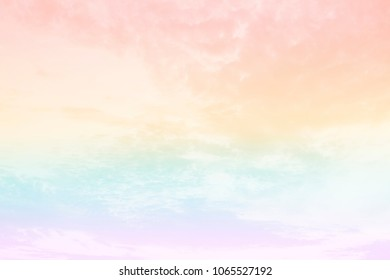 A soft cloud background with a pastel colored purple, blue, green, yellow and pink