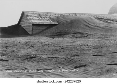 Soil drifting over a farm building on a South Dakota farm in 1935. Dakota was north of the 'Dust Bowl,' but the 1930s drought and decades of intensive farming on the Great Plains.