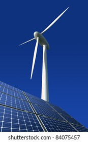 Solar panels and wind turbine against a blue background