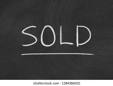 sold concept word on a blackboard background