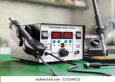 Soldering iron digital station on the workplace. 3d render illustration