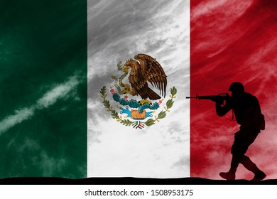 Soldier or police in combat position with rifle with Mexico flag background.