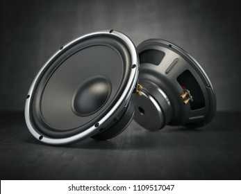 Sound speakers. Multimedia acoustic sound loudspeakers on black rough background. 3d illustration