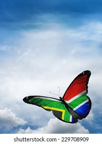 South Africa flag butterfly flying on sky background