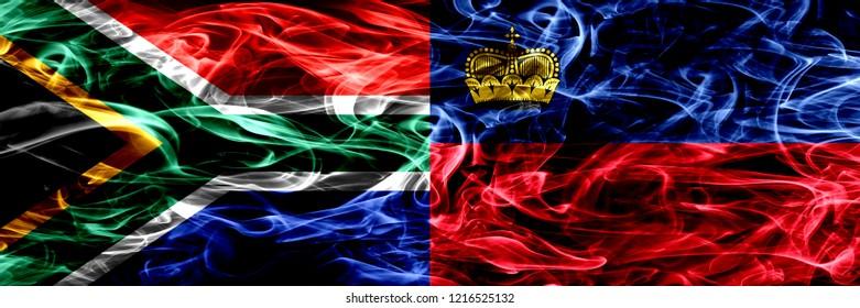 South Africa vs Liechtenstein, Liechtensteins smoke flags placed side by side. Concept and idea flags mix