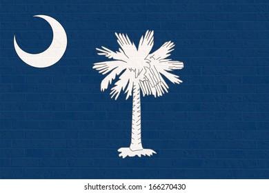 South Carolina state flag of America on brick wall, isolated on white background.
