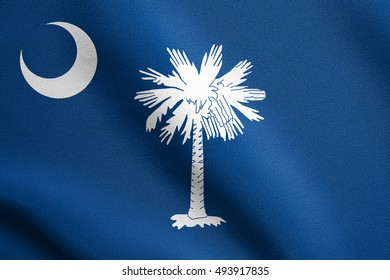 South Carolinian official flag, symbol. American patriotic element. USA banner. United States of America background. Flag of the US state of South Carolina waving in wind with detailed fabric texture