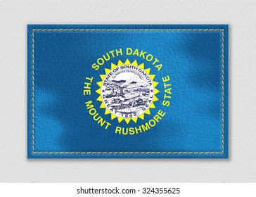 South Dakota flag leather label on a white leather background,vintage style