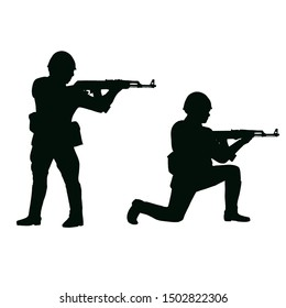 Soviet soldiers with 1980's style uniforms and weapons. Silhouette on white background