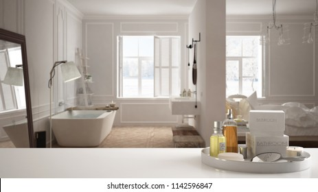 Spa, hotel bathroom concept. White table top or shelf with bathing accessories, toiletries, over blurred white scandinavian bathroom, modern architecture interior design, 3d illustration