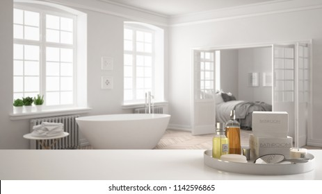 Spa, hotel bathroom concept. White table top or shelf with bathing accessories, toiletries, over blurred vintage bathroom with bedroom, modern architecture interior design, 3d illustration