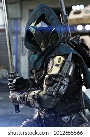 Space hunter, science fictional armored marine posing with multiple weapons and sword in hand. 3d rendering