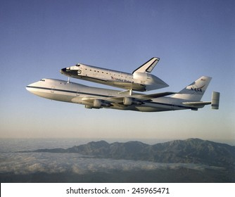 Space shuttle Atlantis atop the a customized 747 flies piggy back to the Kennedy Space Center after a ten month refurbishment. Sept. 1, 1998