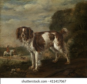 A Spaniel, by Paulus Potter, 1653, Dutch painting, oil on panel. A landscape with a partridge dog and a hunter on horseback with dogs in the background