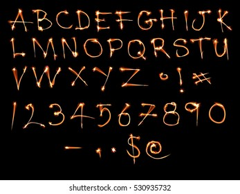 Sparkle alphabet isolated on black.