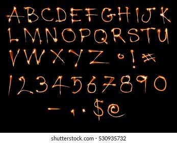 Sparkle alphabet isolated on black.