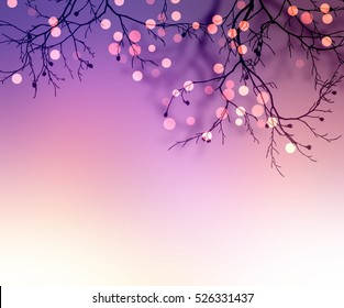 Sparkles on branches of tree. Blurred purple background. Festive texture. Holiday night background.