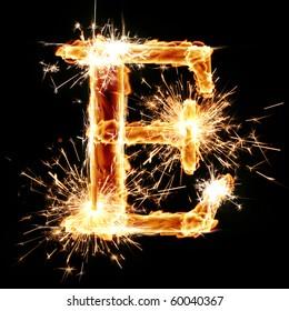 sparkling font: letter E on a dark background