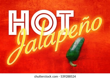 Spicy green pepper on red background with the text Hot Jalapeno in hot colors. Very hot and high on the Scoville scale.