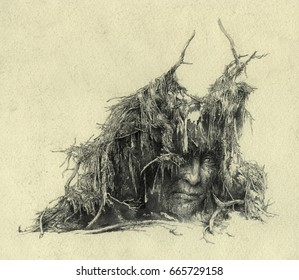 Spirit of the fallen tree. Sad human face under the roots.