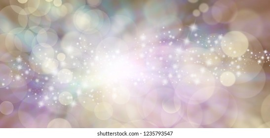 Spiritual Ethereal Angelic starry glitter bokeh background banner - flesh toned natural bokeh  background colours with random sparkles stars and glitter with a white burst of light