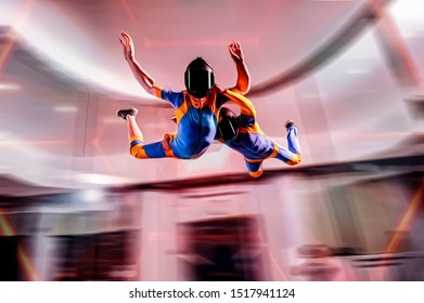 Sport. New indoor sport for flying people.  Indoor skydiving sportsmens fly in tunnel