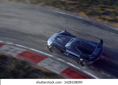 Sports car on racetrack (3D rendering)