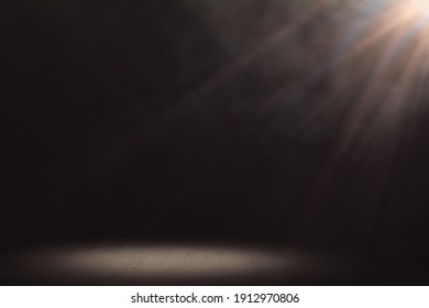 Spotlight from above and lit light floor with smoke