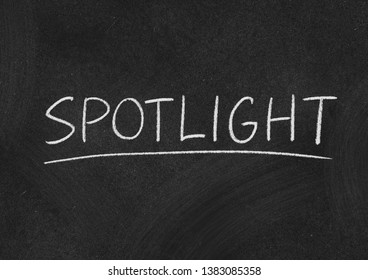spotlight concept word on a blackboard background