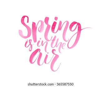 Spring is in the air. Inspirational quote about spring season, pink brush lettering isolated on white background.