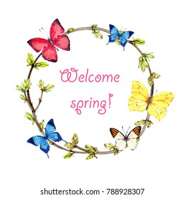 spring wreath from twigs, young foliage and butterflies