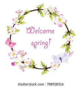 spring wreath from twigs, young foliage, butterflies and spring flowers