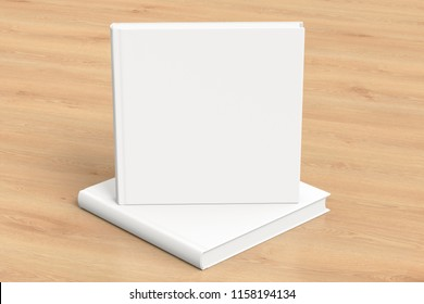 Square blank book cover mockup standing on square blank book with clipping path around books on wooden background. 3d illustration