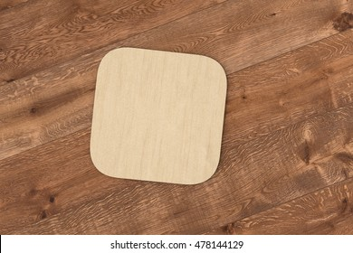 Square cardboard coaster. Isolated on wood background. 3d render
