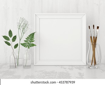 Square interior poster mock up with empty frame, artistic brushes and plants in bottles on white wall background. 3D rendering.