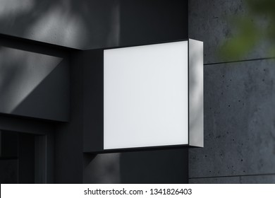 Square light box with company name on dark concrete building wall. Concept of advertising and marketing. 3d rendering mock up
