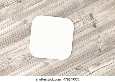 Square paper coaster. Isolated on wood background. 3d render