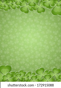 St. Patrick's Day on green background with clovers